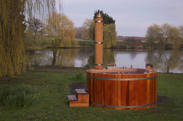 Wood fired hot tub by a lake